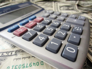 5-calculator-and-money-by-401K2012